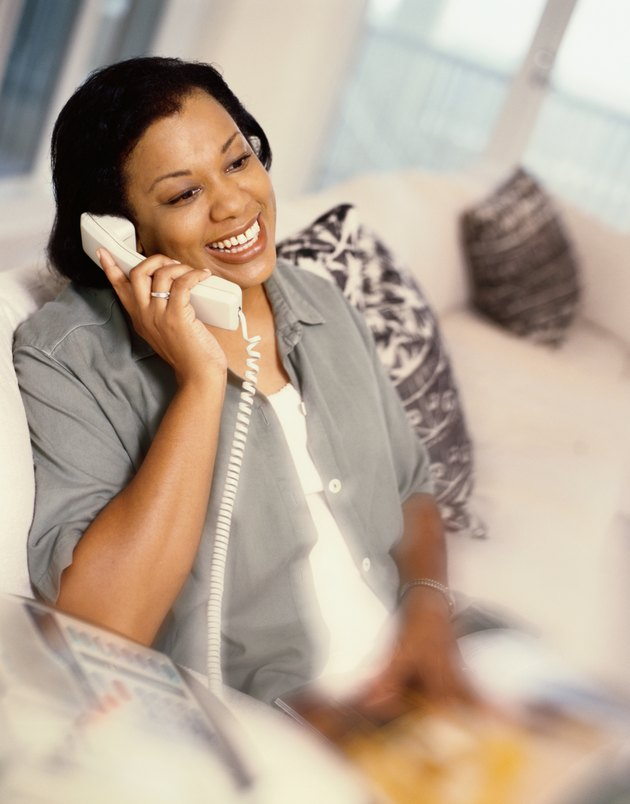 Woman Talking on a Telephone