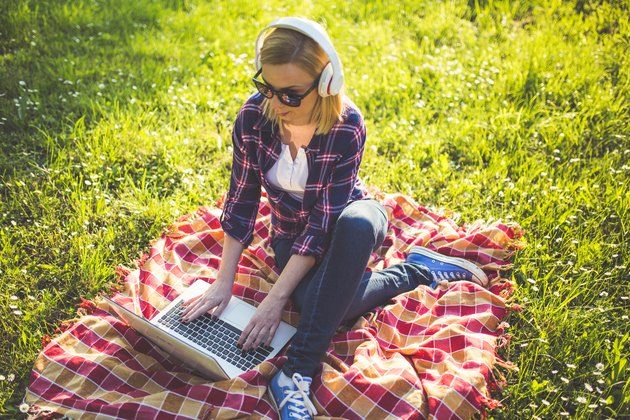 Girl with glasses using laptop