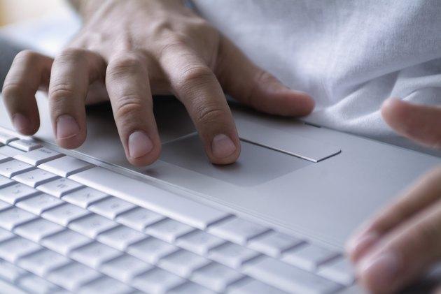 Human Hands operating a Laptop