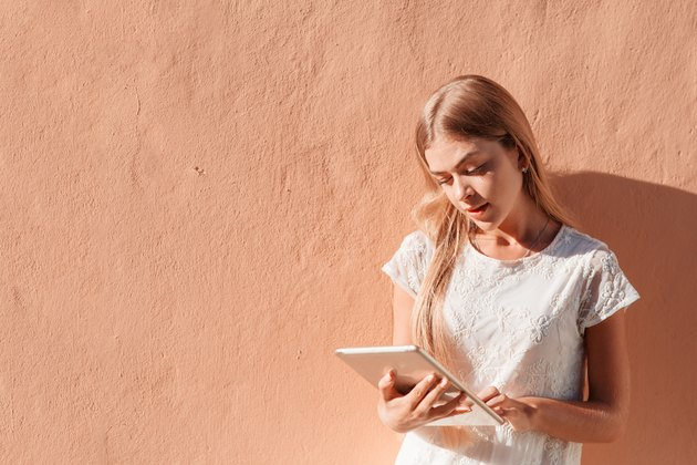 Elegant young woman using tablet