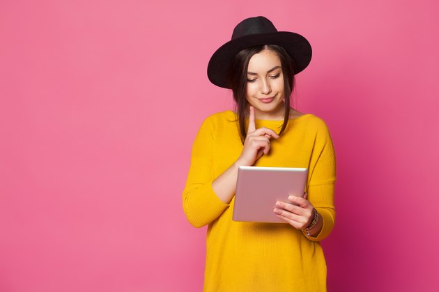 young fashionable woman using tablet