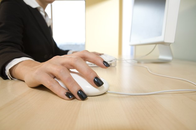 Close-up of woman's hand holding a computer mouse