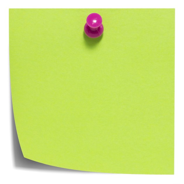 Green square sticky note, with a pink pin, isolated