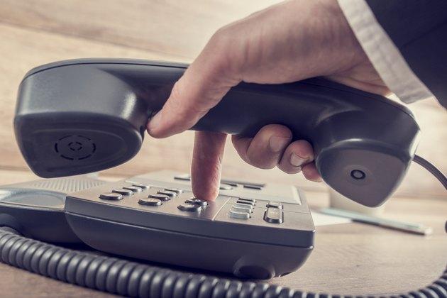 Closeup of businessman making a telephone call