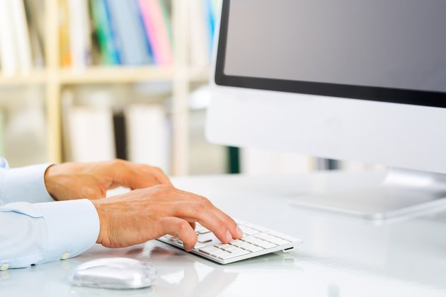 Businessman's Hands Typing on Keyboard