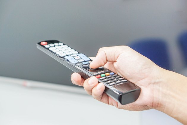 Turn on TV with remote control in hand
