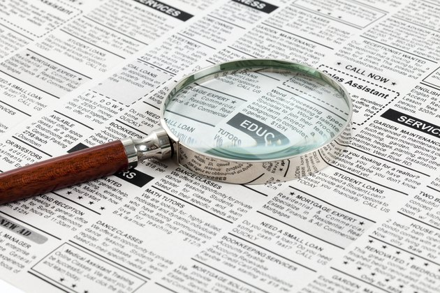 Classified Ad and magnifying glass
