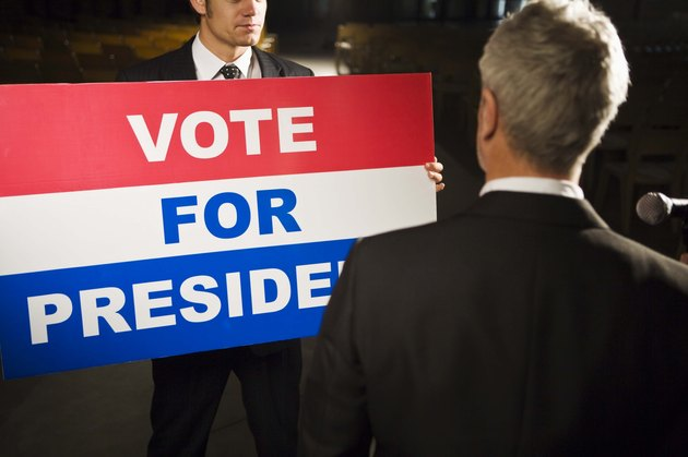 Politician with Vote For President sign