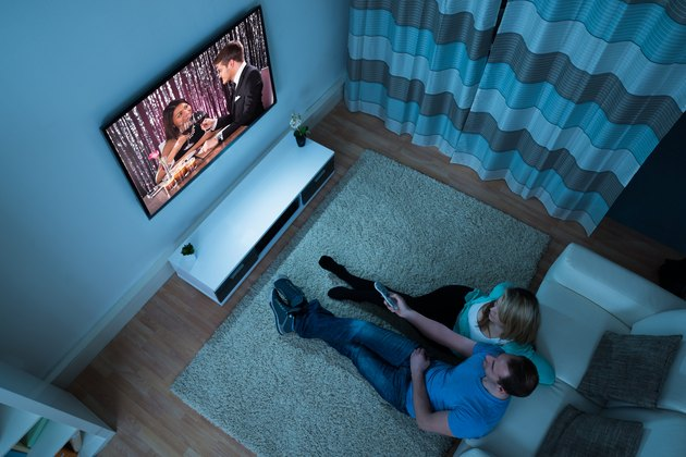 Couple Watching Movie In Living Room
