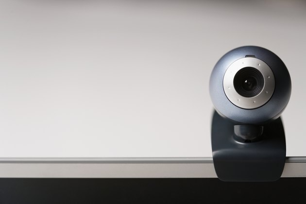 Clip-on webcam mounted on laptop computer