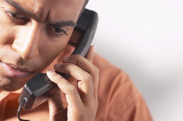 Serious man on telephone