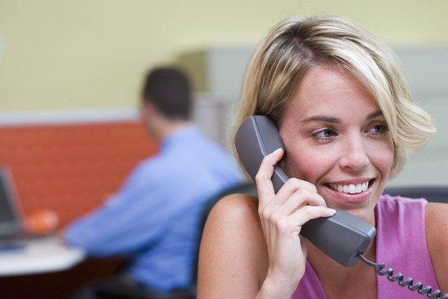 Close-up of a businesswoman talking on a telephone in an office