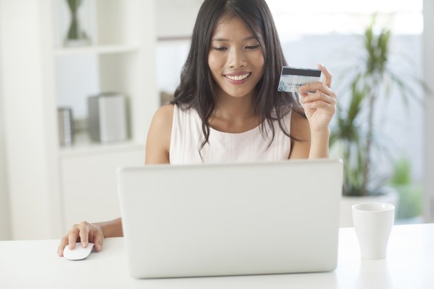 Smiling Asian Woman Shopping Online