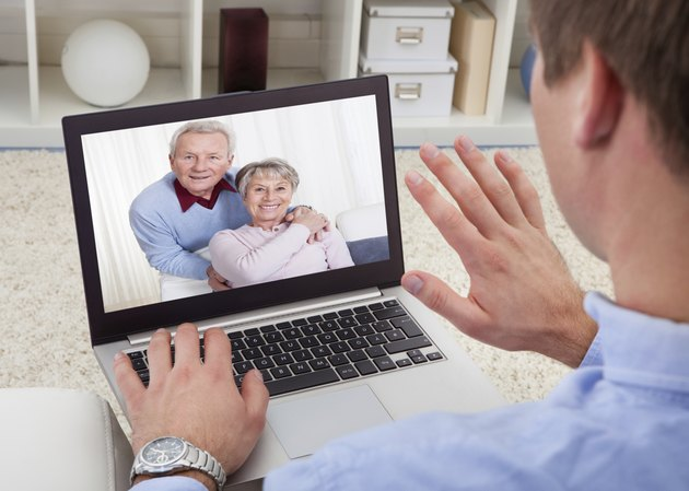 Man Video Conferencing On Laptop