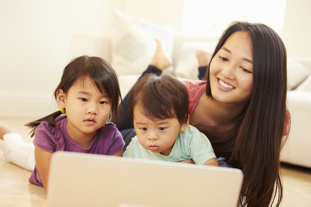 Mother And Children Using Laptop Together