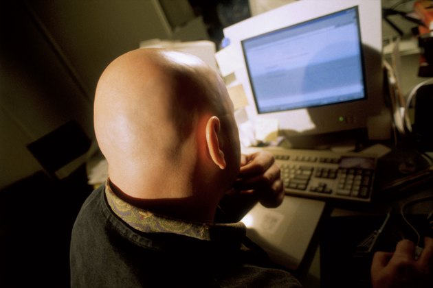 Young man working in front of computer