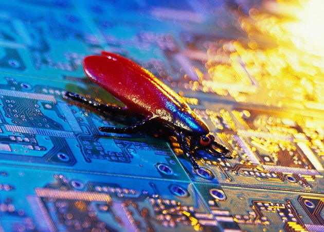 close-up of a fly sitting on a circuit board