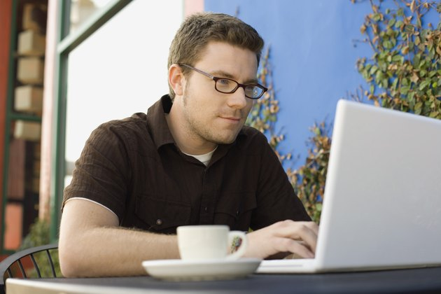 Hipster man using laptop computer