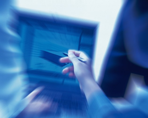 Photography of Three people working together with a computer at the desk, Portrait, Rear View, Toned Image, Blurred Motion