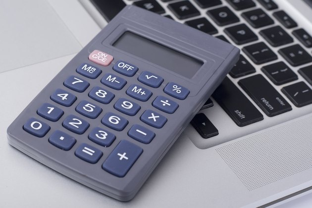 calculator on the laptop keyboard