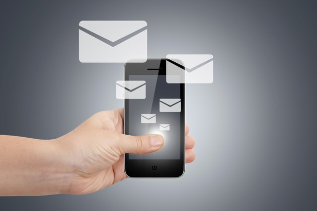 Hand with Smart Phone and Email Icons