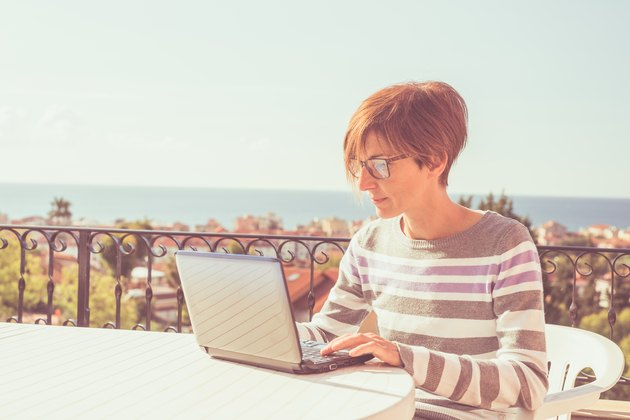 Woman working at home with netbook outdoors