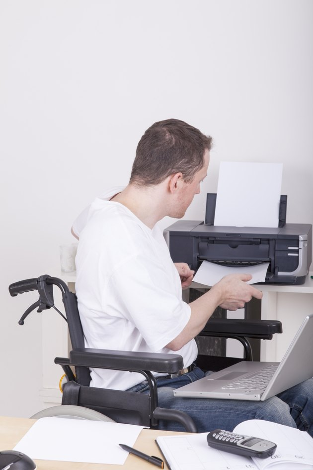 disabled man in wheelchair at work