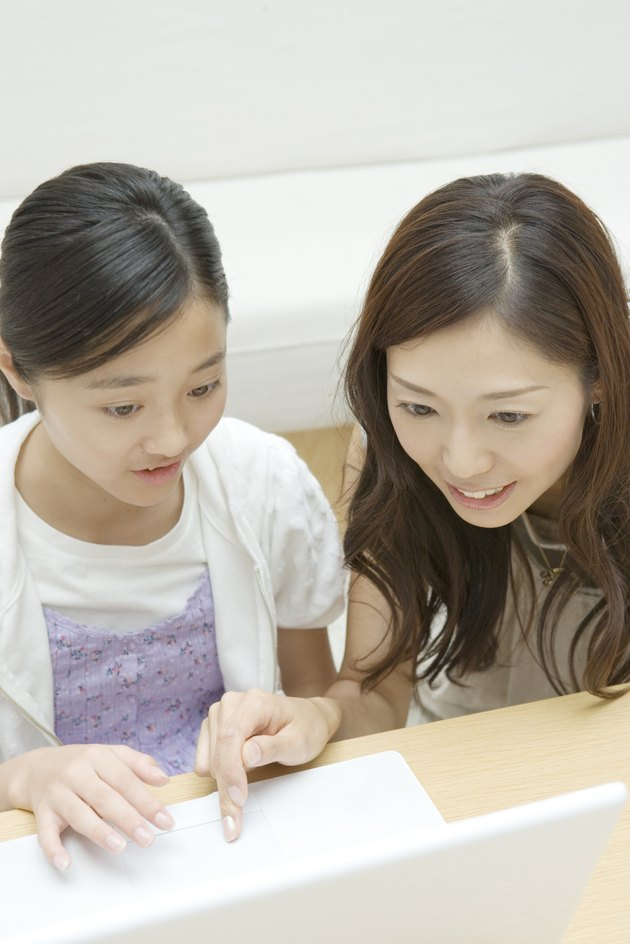 Mother and daughter using PC