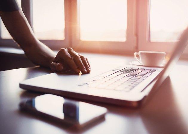 Male hand on laptop keyboard