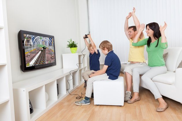 Young family playing video games