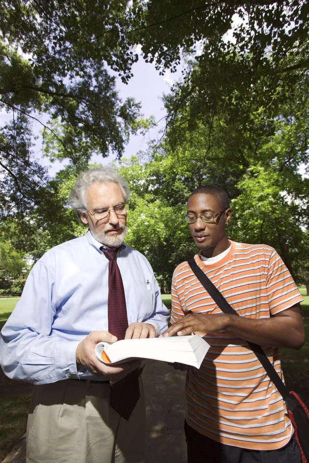 Professor helping student outdoors
