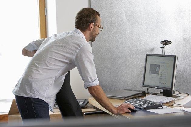 man stands at desk