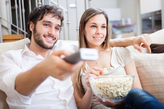 Couple using a remote control