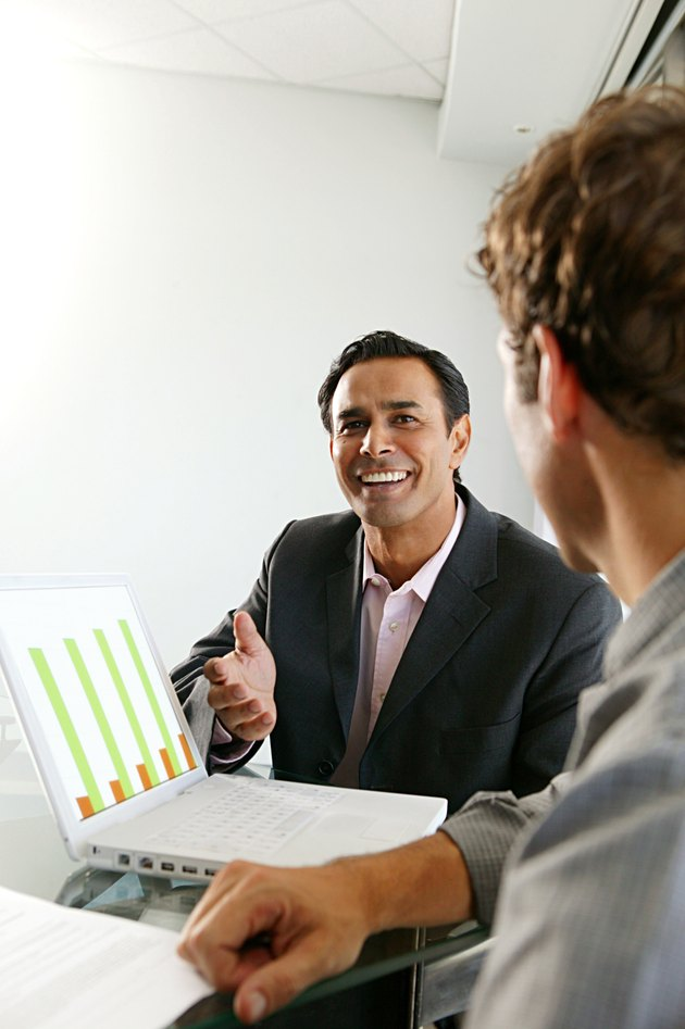 Man making presentation to colleague