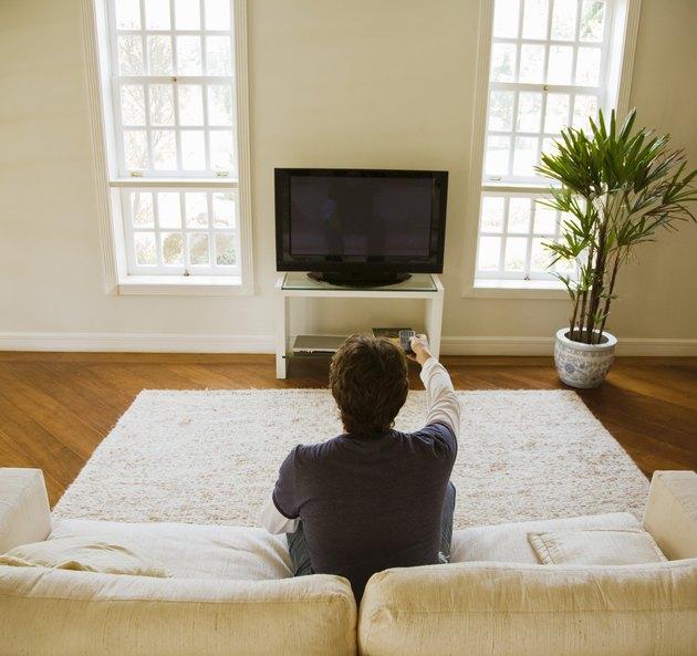 Man watching TV in modern living room