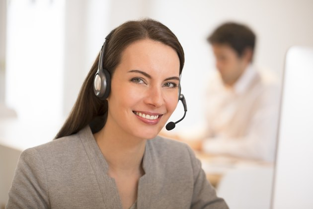 Beautiful Businesswoman in the office on the phone, headset
