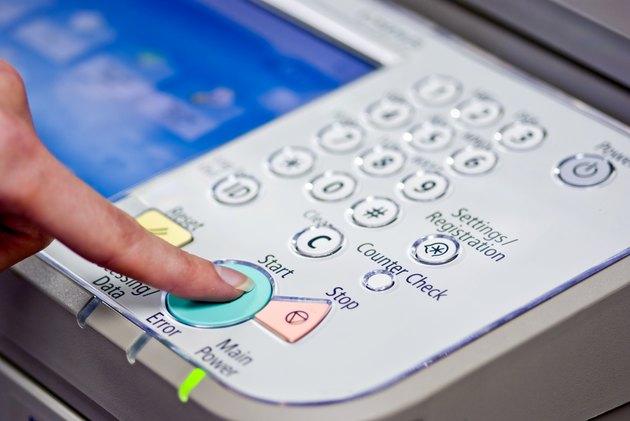 Pressing Start Button on Copy Machine