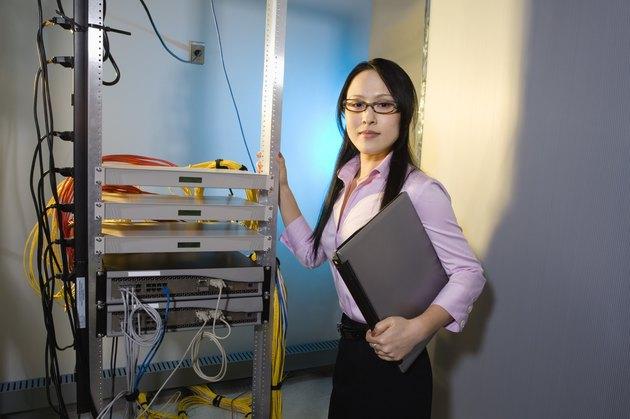 Woman in computer server room