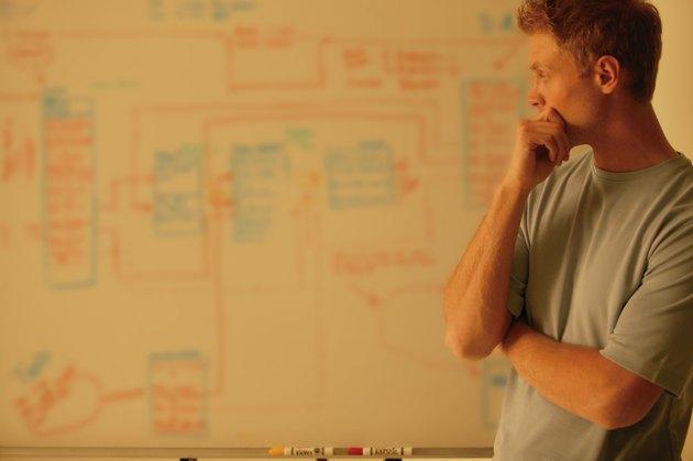 Man analyzes workflow chart