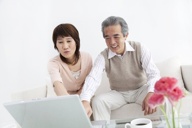 Husband and wife using a laptop