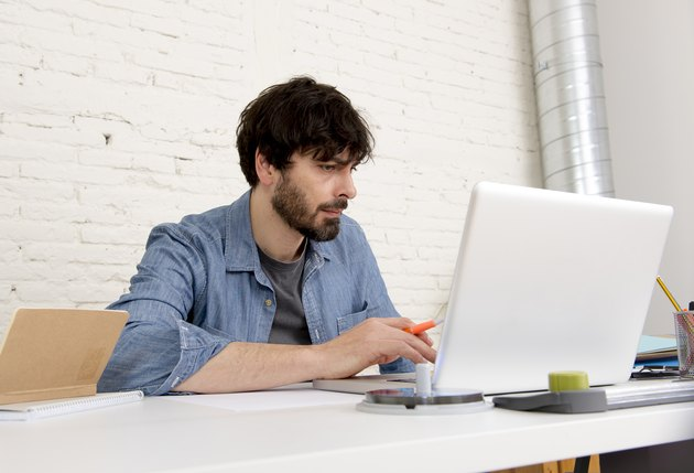 corporate portrait young hispanic hipster businessman working home office