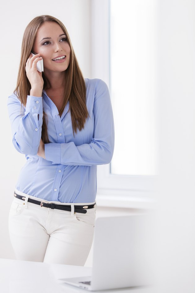 Beautiful businesswoman using cell phone