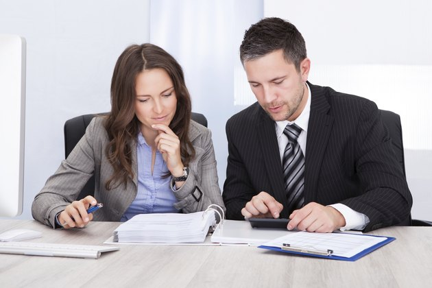 Businesspeople Calculating Finance