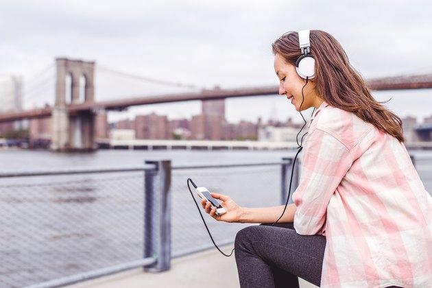 Woman listening music on cellphone
