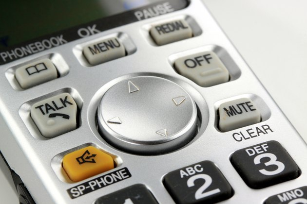 Silver cordless phone keypad closeup