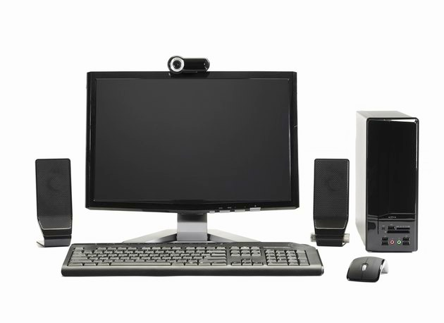 Computer with mouse, speakers and webcam