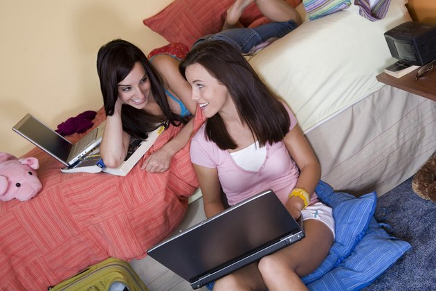 Teenage girl and a young woman using a laptop