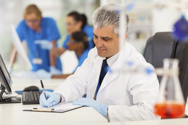 middle aged medical researcher working in lab