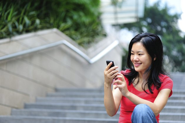 young asian use smartphone