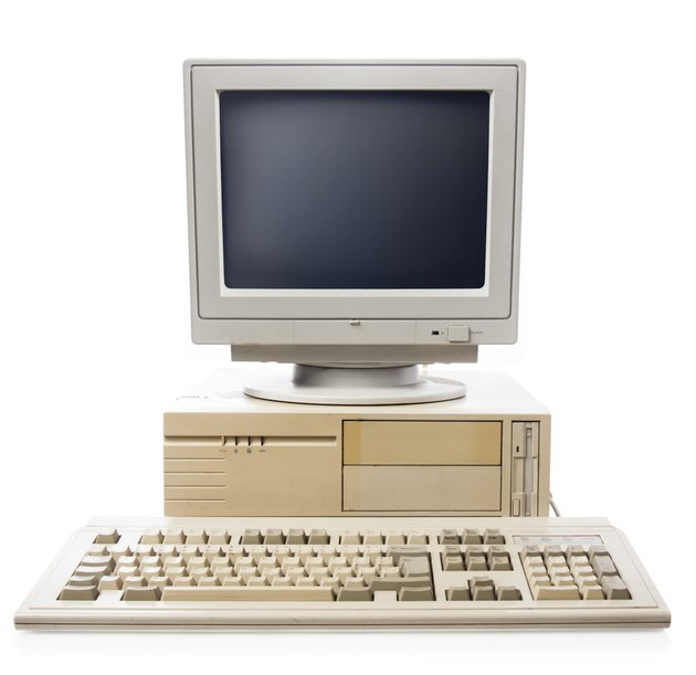 Old computer, keyboard CPU and monitor isolated on white